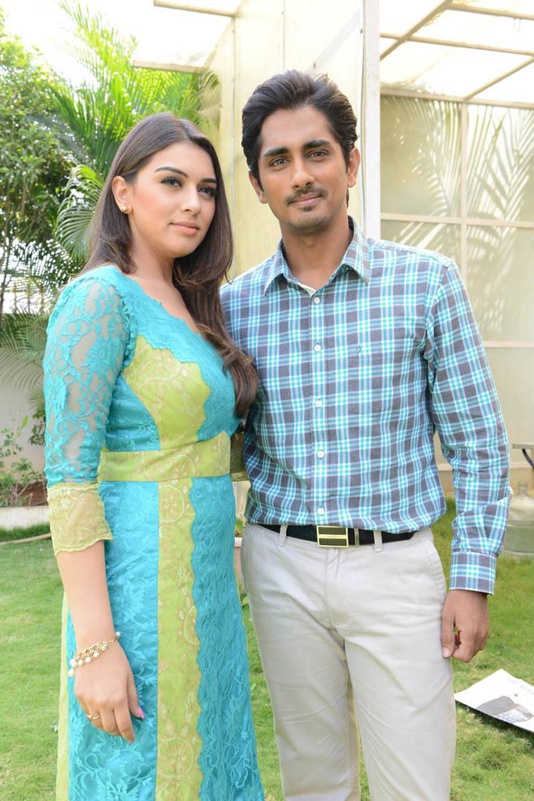 Hansika And Siddharth Posed For Camera At Something Something Movie Press Meet