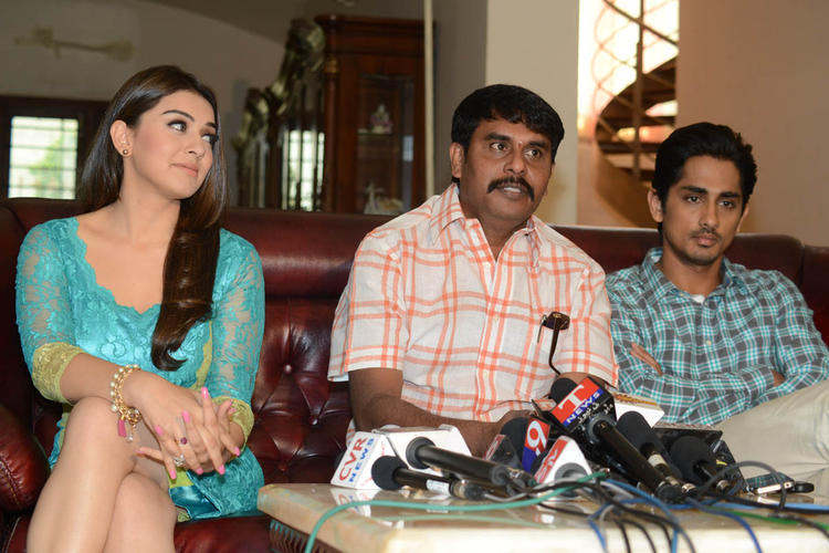 Hansika,Sundar C And Siddharth Spotted At Something Something Movie Press Meet