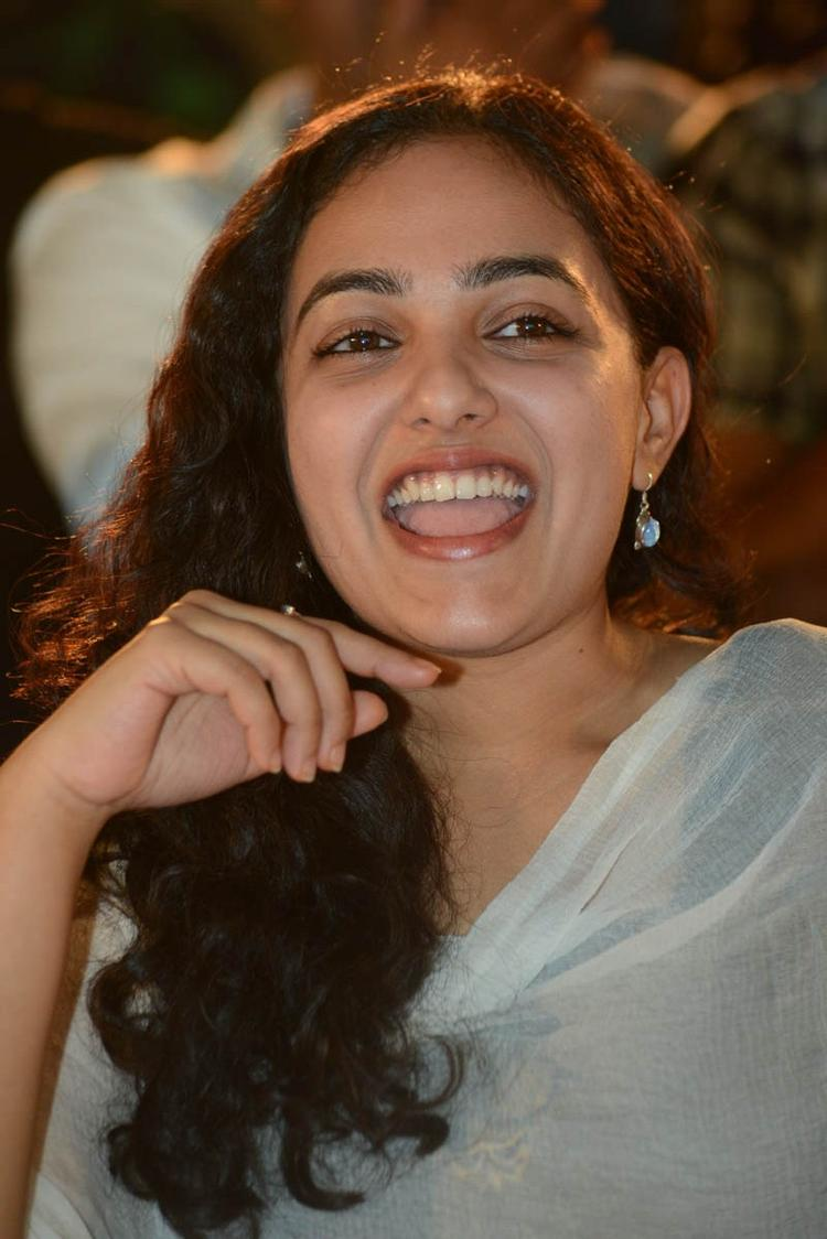 Nithya Menen Laughing Still At Gunde Jaari Gallanthayyinde Movie Audio Release Function