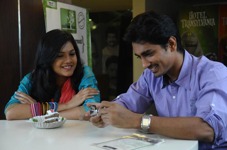 Siddharth And Ashrita Nice Smiling Photo Still From Movie Udhayam NH4