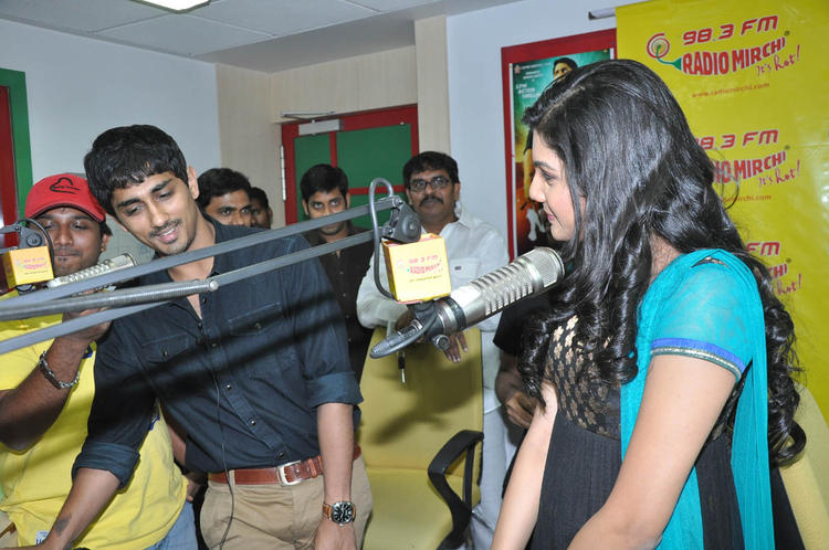 Siddharth And Ashritha Spotted At Udhayam NH4 Movie Audio Launch