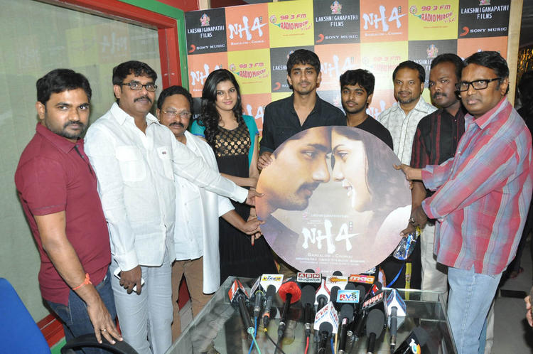 The Team Posed With Audio CD At Udhayam NH4 Movie Audio Launch