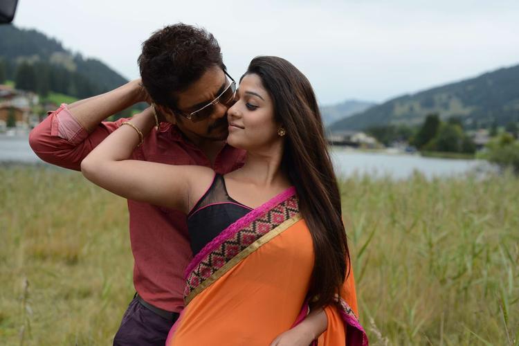 Nagarjuna And Nayantara Kissing Photo Still From Movie Greeku Veerudu