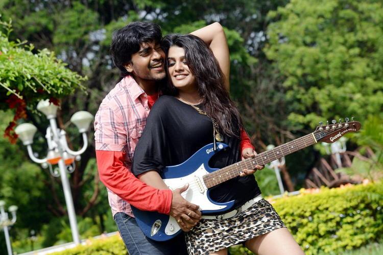Srinivas And Tashu Guitar Playing Photo Still From Movie Gola Seenu