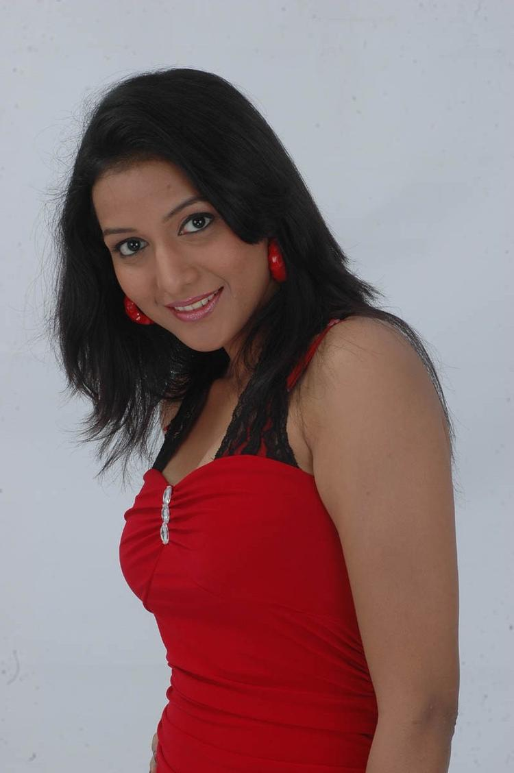 Ujjaini Sizzling Look Photo Still In A Red Enseble From Movie Lavvata
