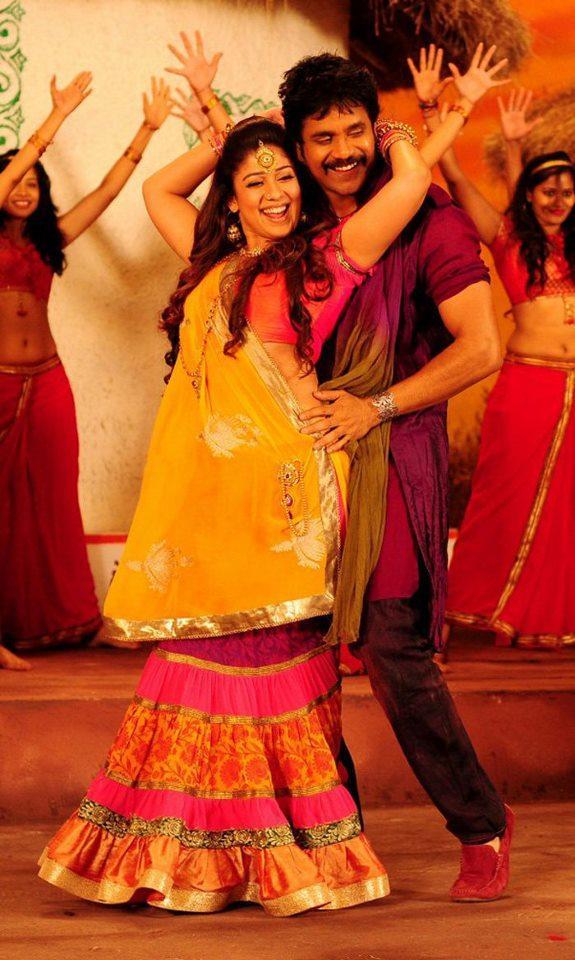 Nagarjuna And Nayantara Smiling Dance Photo Still From Movie Greeku Veerudu