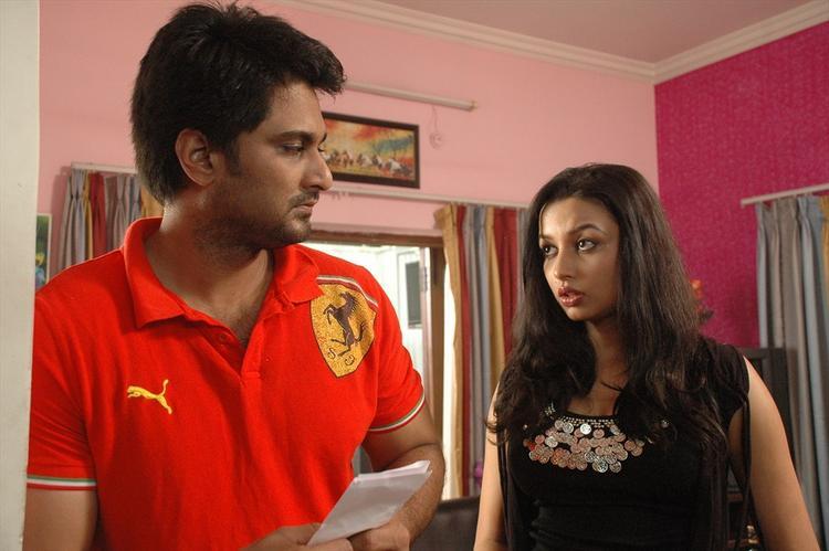 Rishi And Richa Sinha A Still From Srimati Bangaram Movie