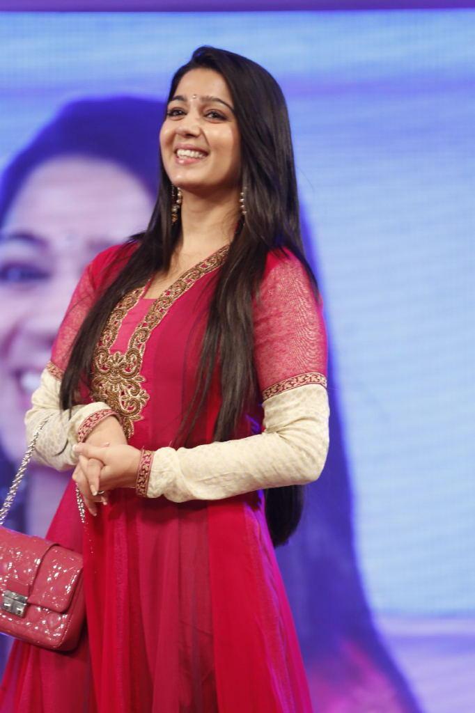 Charmy Kaur Cute Face Look At TSR TV9 Film Awards Function
