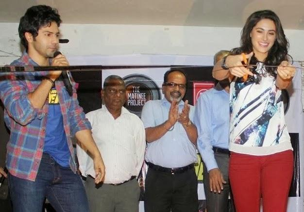 Nargis Fakhri Cuts The Ribbon And Varun Dhawan Looks On During The Promotion Of Main Tera Hero At Mithibai College