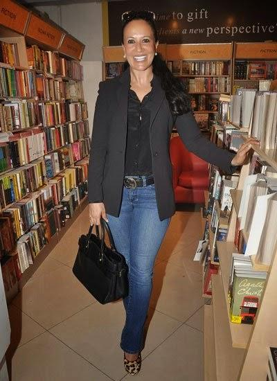 A Guest Flashes Smile At The Launch Of Dr Rashmi Shetty Age Erase Book