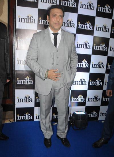 Govinda Poses For The Media At IMFAA 2014 In Mumbai