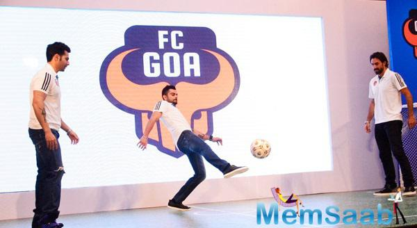 Virat Kohli Kicks The Ball,Varun Dhawan And Robert Pires Look On At FC Goa Official Jersey Launch