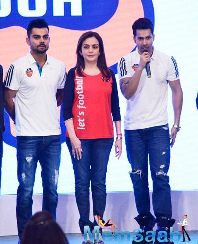 Virat Kohli,Nita Ambani And Varun Dhawan Posed For Media During The Jersey Launch Of FC Goa
