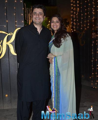Actress Sonali Bendre Looked Lovely In A Sari As She Posed For Pictures Along With Husband Goldie Behl