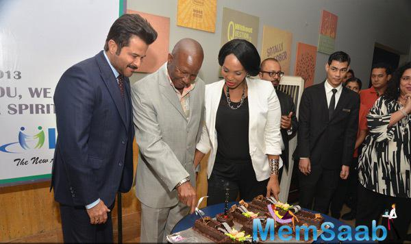 Pule Malefane Cuts Cake And Anil Kapoor Looks On At Nelson Mandela First Death Anniversary Function