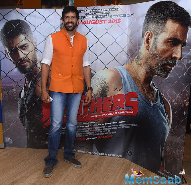 Kabir Khan Cool Smiling Pose At The Special Screening Of Brothers Movie