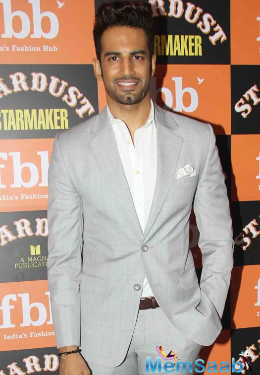 Upen Patel Smiling Pose During The Launch Of Stardust Starmaker
