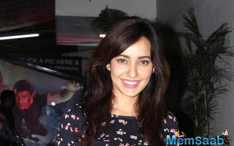 Neha Sharma looks cute in this floral-printed top and jeans at the special screening of Aligarh