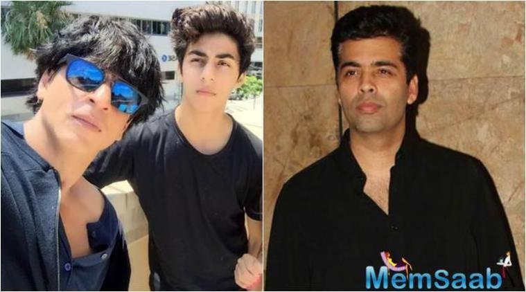Karan Johar, who called himself as Aryan's God Parent , said he will launch SRK's son Aryan in Bollywood after finishes his studies .