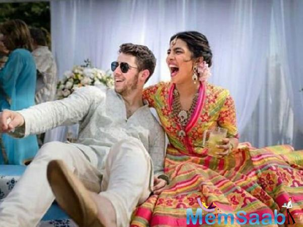 Priyanka, 36, wore a red sari, while Jonas, 26, was dressed in a traditional outfit and turban, People magazine reported late Sunday.