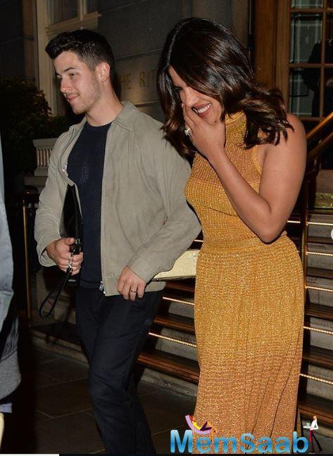 The couple had been staying at The Ritz Hotel in London and were all smiles as the shutterbugs clicked continuously.