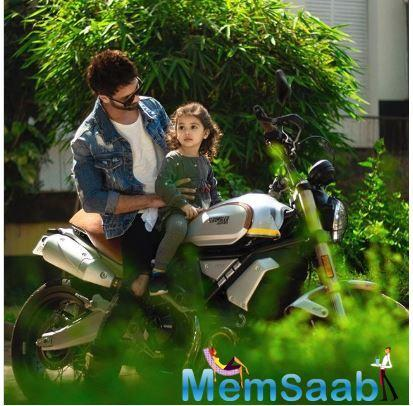Shahid Kapoor shared this cute picture of Misha who is seen making an attempt to outdo her daddy dearest.