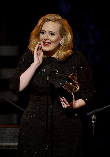 British Singer Adele holds her Grammy Awards
