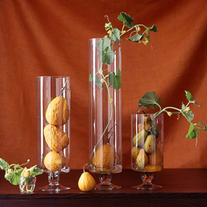 fruits and vines in glass containers