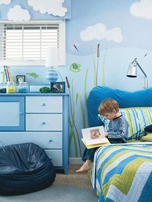 Boy reading book on bed in frog pond bedroom