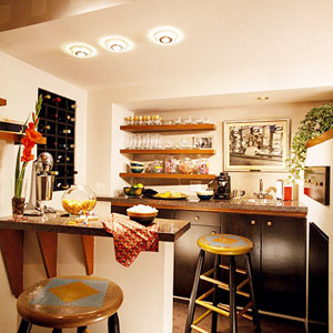 wet bar with open shelves for stemware
