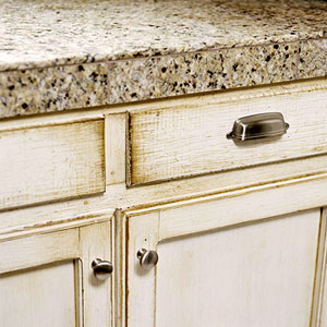 grayish glazed and distressed cabinets, granite-tile countertop