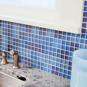 blue tile backsplash behind sink