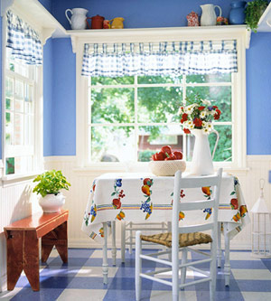 Blue & white kitchen w/ shelves over windows and multi-color vinyl tiles