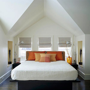 bed in nook with  bright pillows