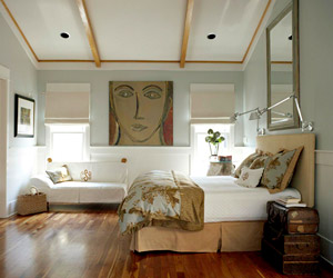 contemporary bedroom w/large artwork on back wall