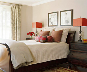 bedroom w/red square bed lamps