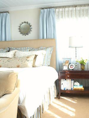 bedroom w/sund mirror above bed