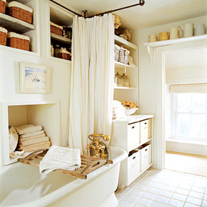 white bathroom with baskets on shelves