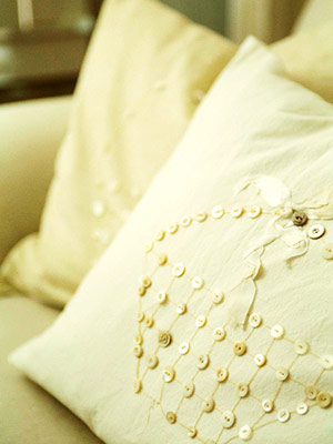 white pillow with buttons