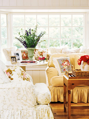 slipcovered sofas with floral pillows