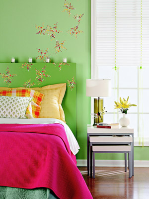 green bedroom with wall decals and candles