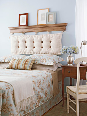 blue bedroom with cushion headboard