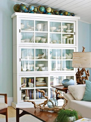 Globes on white glass cabinet