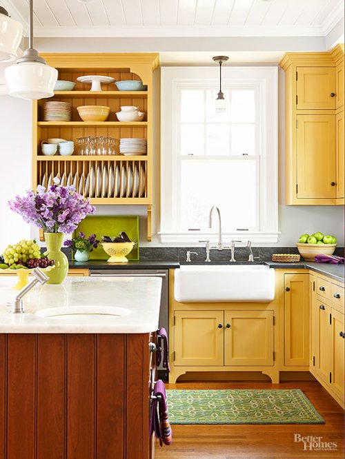 Painted Kitchen Cabinets Cabinetry Color Colorful Yellow Dull Muted Farmhouse Sink Apron Apron-Front Open Shelving Beadboard Island Green Rug Wood Floor Pendant Light Shaker