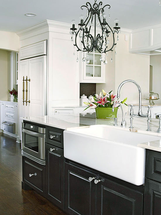 Statement Sink in White Paired with Black Cabinets Chandelier Hardwood Floors Exotic Flowers