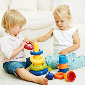 toddlers playing with a ring game
