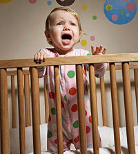 baby in crib crying