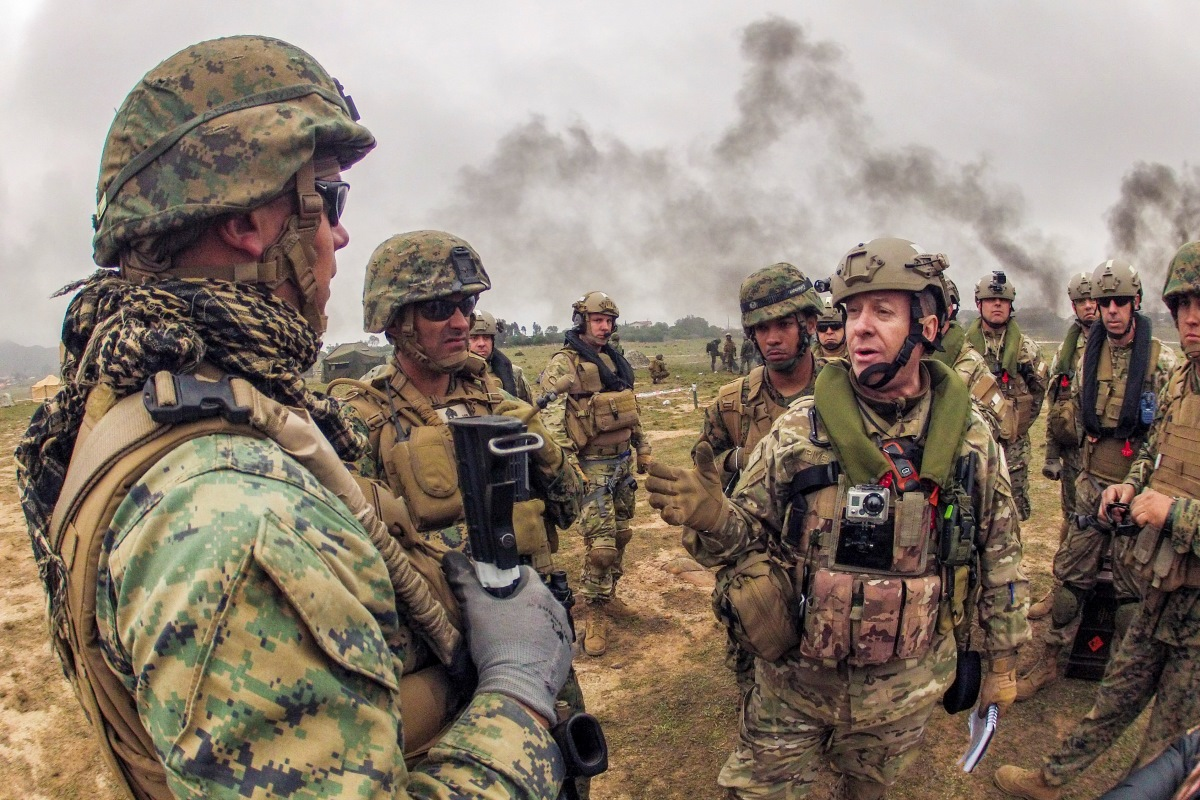 U.S. Marines discuss crowd control strategies with Chilean Marines during Partnership of the Americas (POA) 2014. (Mass Communication Specialist 1st Class Paul Seeber)