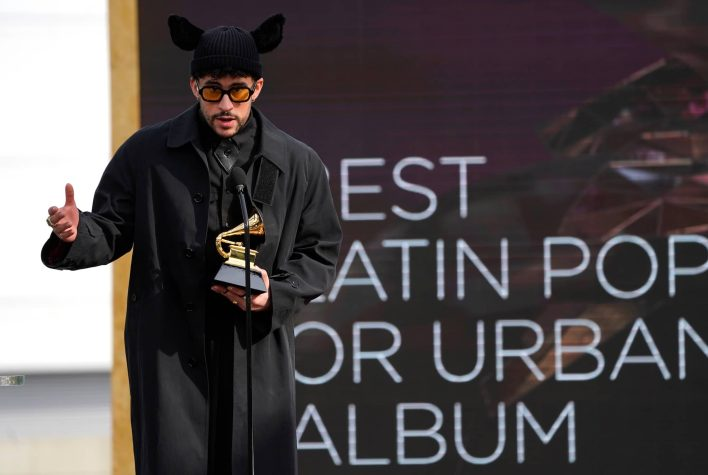 """Bad Bunny accepts the award for best latin pop or urban album for """"YHLQMDLG"""" at the 63rd annual Grammy Awards at the Los Angeles Convention Center on Sunday, March 14, 2021. (AP Photo/Chris Pizzello)"""