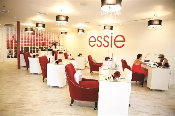 A Wall Featuring Some Of Essie S 300 Polish Colors Is The Perfect Backdrop To Eight Manicuring Stations
